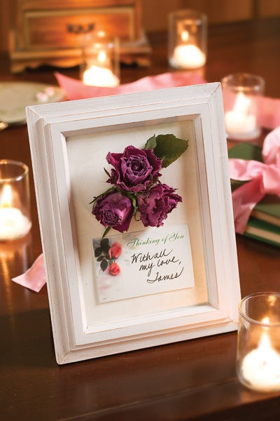 Framed Dry Rose in a White Frame surrounded by beautiful candles