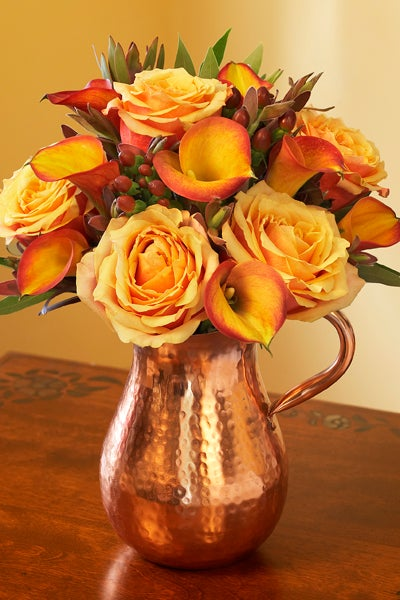 Bronze Pitcher with Peach Roses