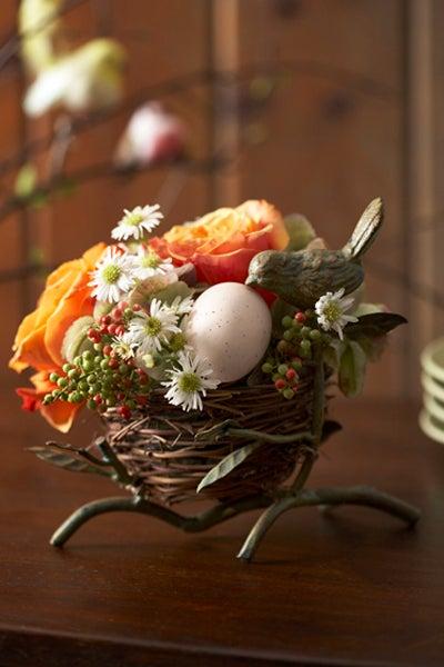 Flower and Faux egg nest arrangement