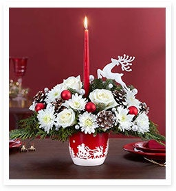 Reindeers and Flowers Fly High in Santa's Sleigh Ride™ Centerpiece.