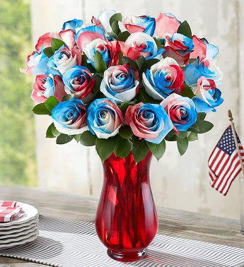 Kaleidoscope Roses: Red, White & Blue  24 Stems with Red Vase