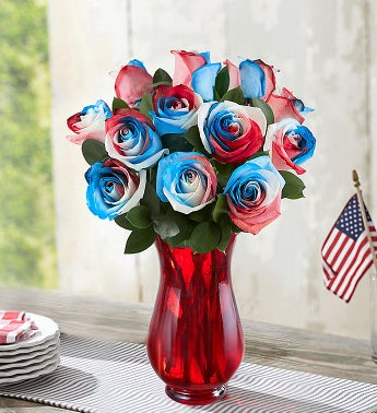 Kaleidoscope Roses: Red, White & Blue  12 Stems with Red Vase